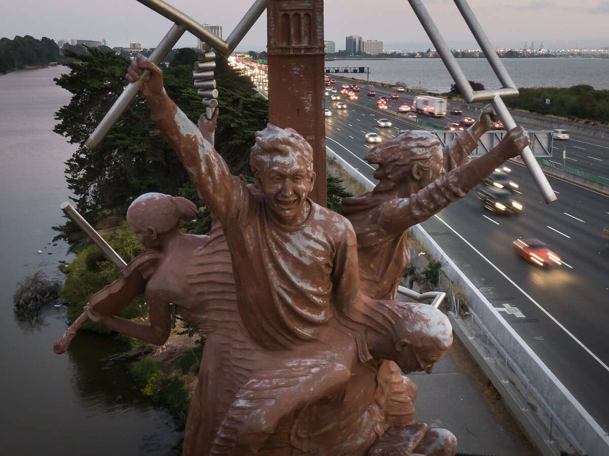 """A """"Berkeley Big People"""" sculpture stands at the pedestrian bridge over Interstate 80, south of University Ave. on Sunday, Aug. 18, 2019, in Berkeley, Calif."""