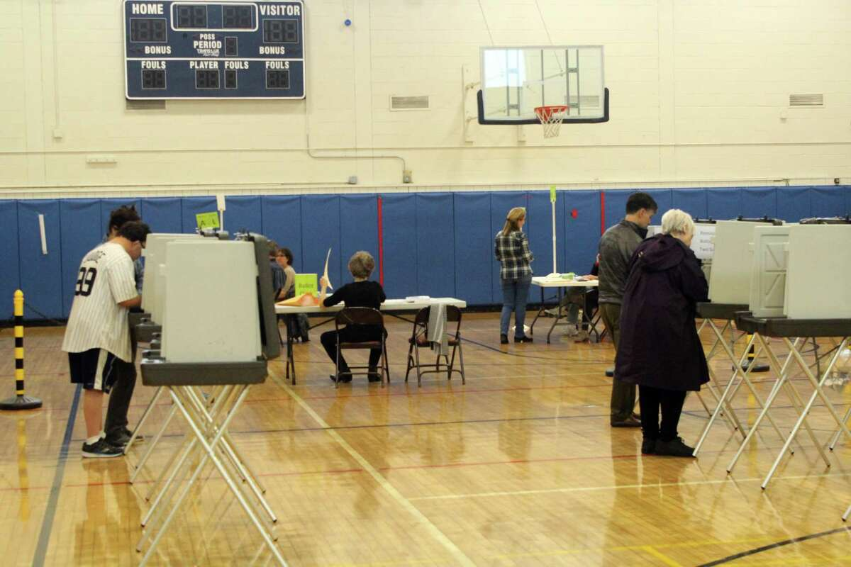 Weston residents showed up to Weston Middle School to vote on Tuesday.
