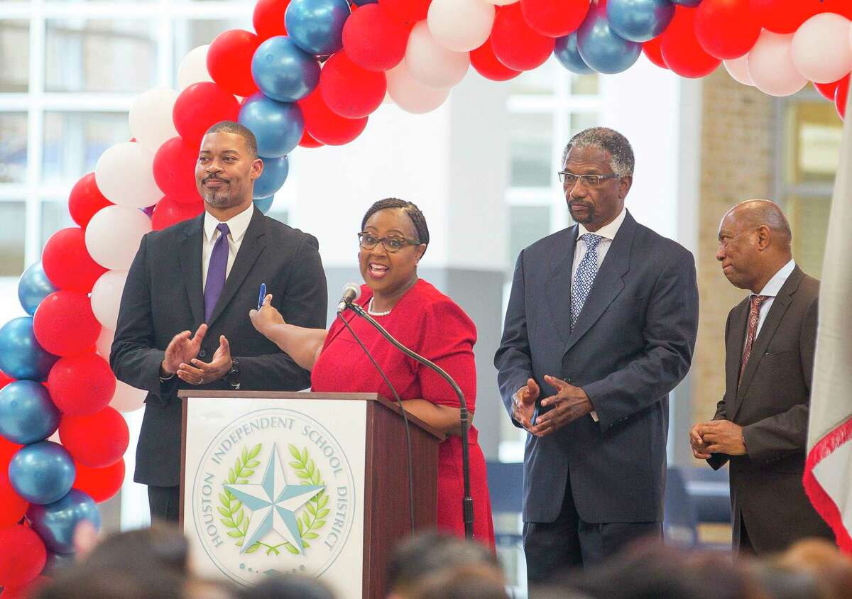 In this August file photo, Houston ISD Interim Superintendent Dr. Grenita Lathan (center) acknowledges Wheatley High School principal Joseph Williams (left) during a celebration marking Kashmere High School's meeting of state expectations for the first time in 11 years at the school in Houston. Barring an unexpected turn, Wheatley will trigger state sanctions in the coming months after the historic Houston Fifth Ward campus received its seventh consecutive failing grade this year.
