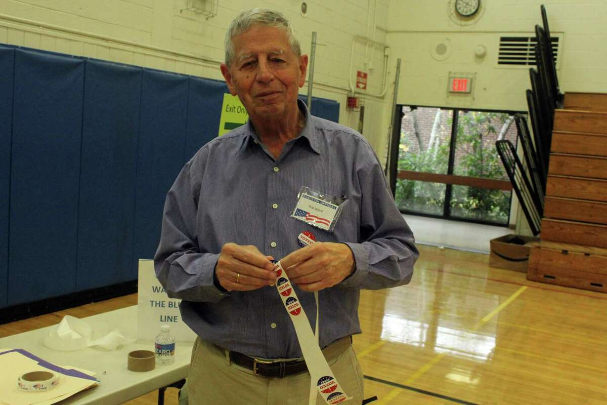 Rob Schaaf, Weston Election official, handed out