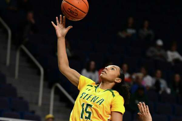 Siena's Chyvon Thomas drives to the basket guarded by Binghamton's Annie Ramil during a basketball game at the Times Union Center on Tuesday, Nov. 5, 2019 in Albany, N.Y. (Lori Van Buren/Times Union)
