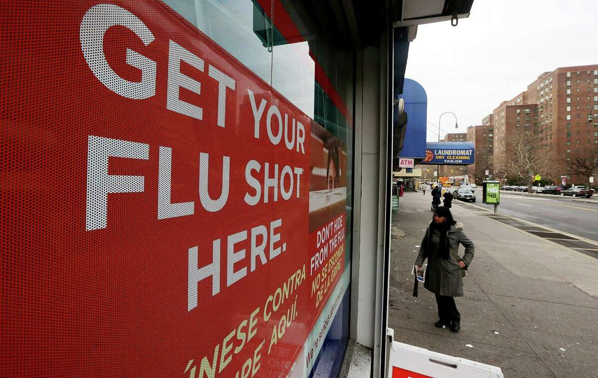 A sign advertises flu shots. Flu season has started this year.