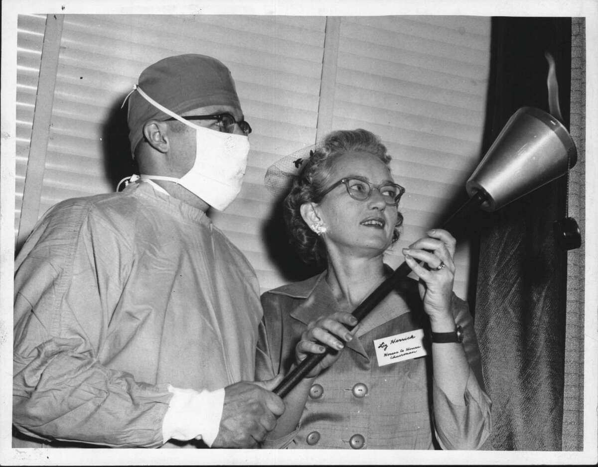 Jack Clas, treasurer, and Mrs. C. Robert Herrick, house to house chairman, hold 'a torch of hope,' as the Albany County Muscular Dystrophy Drive is launched at the DeWitt Clinton Hotel on Nov. 10, 1959. The torch symbolizes the renewed hope brought to those who will benefit from the campaign. (Knickerbocker News Staff Photo/Times Union Archive)