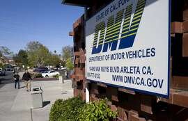 File - In this April 9, 2019, file photo, people approach the California Department of Motor Vehicles office in the Arleta neighborhood of Los Angeles. California's Department of Motor Vehicles improperly disclosed private information to seven other agencies on more than 3,000 people who had been under some type of criminal investigation. The department is sending letters Tuesday, Nov. 5, 2019, to the drivers after determining that none is under current investigation. (AP Photo/Richard Vogel, File)