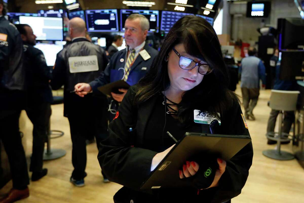 FILE - In this Oct. 30, 2019, file photo trader Phyllis Arena Woods works on the floor of the New York Stock Exchange. The U.S. stock market opens at 9:30 a.m. EST on Tuesday, Nov 5. (AP Photo/Richard Drew, File)