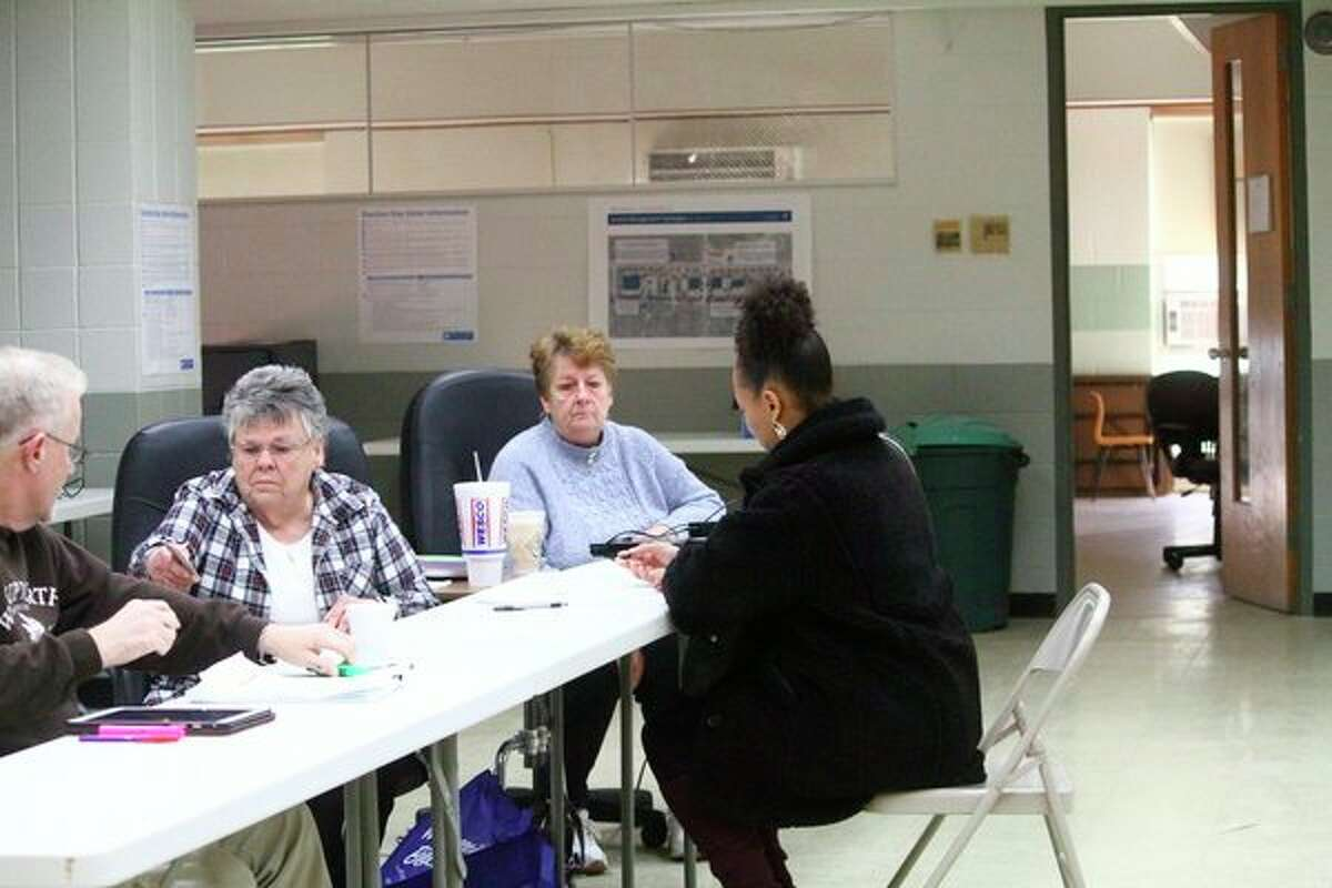 A voter at Webber Township City Hall gets ready to fill out her ballot. (Pioneer photo/ Catherine Sweeney)
