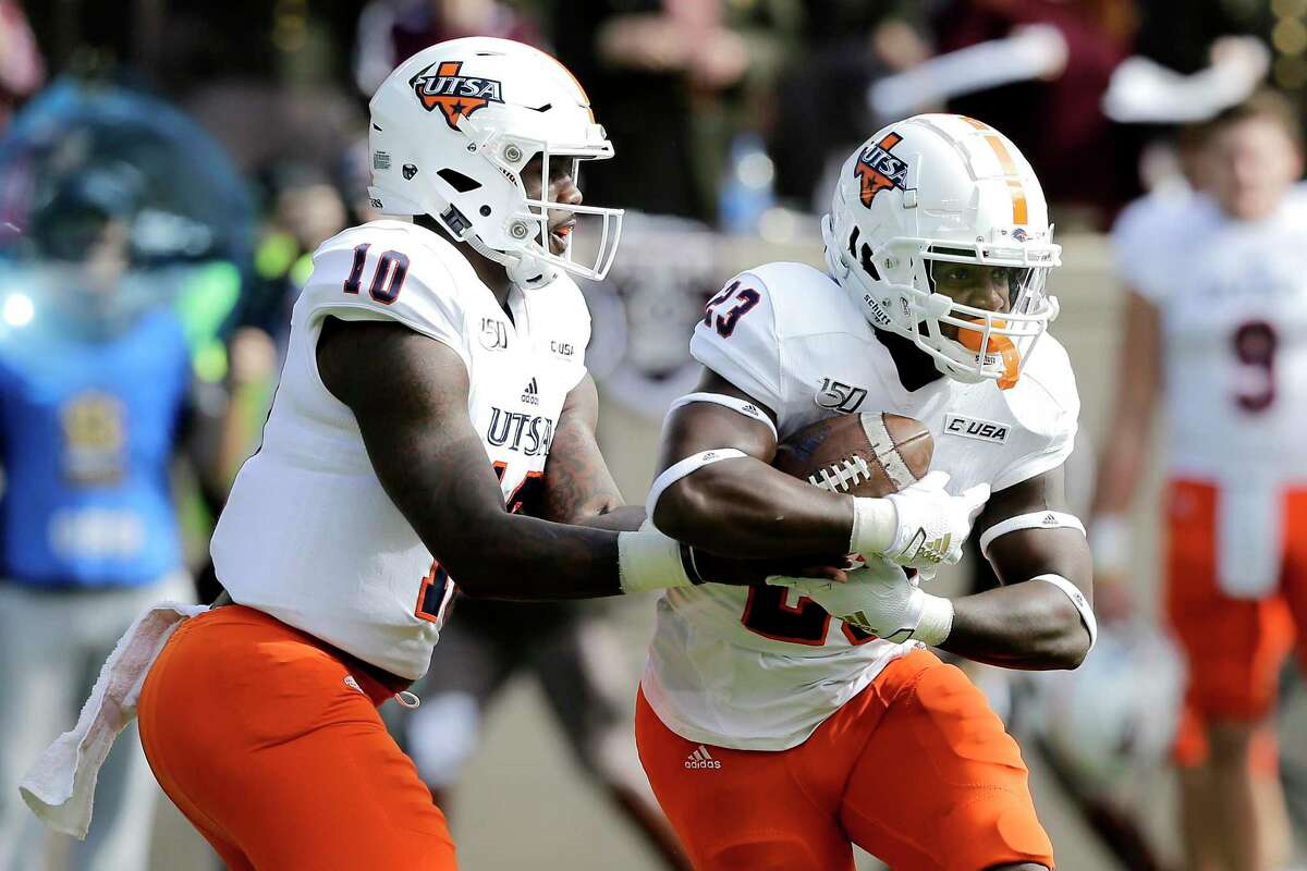 UTSA quarterback Lowell Narcisse (10) hands the ball off running back Sincere McCormick (23) during the first quarter of an NCAA college football game against Texas A&M, Saturday, Nov. 2, 2019, in College Station, Texas. (AP Photo/Sam Craft)