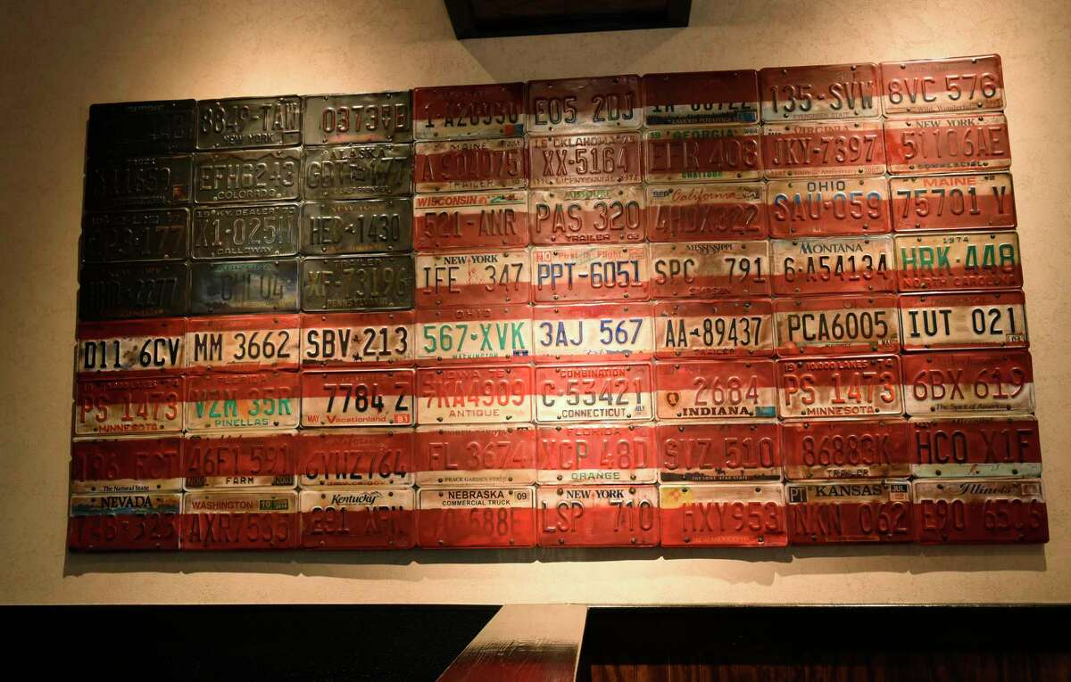 An American Flag made from license plates hangs on the wall in the LongHorn Steakhouse on Wolf Rd. on Tuesday, Nov. 5, 2019 in Colonie, N.Y. (Lori Van Buren/Times Union)