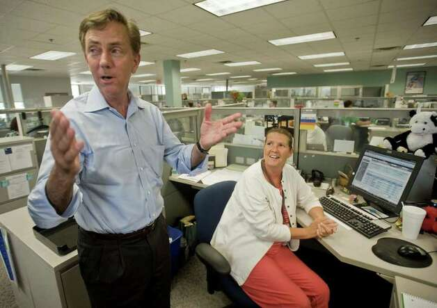 Ned Lamont jokes with CARTUS Senior Client Service Consultant Debbie McCarthy at Danbury's second-largest employer. Lamont toured CARTUS on 40 Apple Ridge Road and met employees. Monday, Aug. 9, 2010 Photo: Scott Mullin / The News-Times Freelance