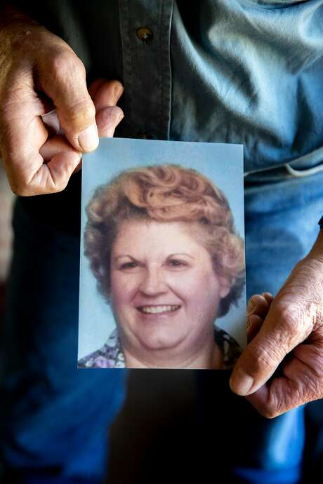Walker holds a photo of Ellen, 73. The remains of Victim No. 53 were found with hers. Photo: Santiago Mejia / The Chronicle