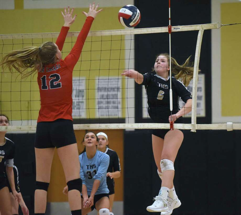 Trumbull's Bailey Cenatiempo (6) puts a shot past New Canaan's Lillie Gray (12) during an FCIAC girls volleyball quarterfinal game at Trumbull High School on Tuesday, Nov. 5, 2019. Photo: Dave Stewart / Hearst Connecticut Media / Hearst Connecticut Media