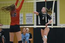 Trumbull's Bailey Cenatiempo (6) puts a shot past New Canaan's Lillie Gray (12) during an FCIAC girls volleyball quarterfinal game at Trumbull High School on Tuesday, Nov. 5, 2019.