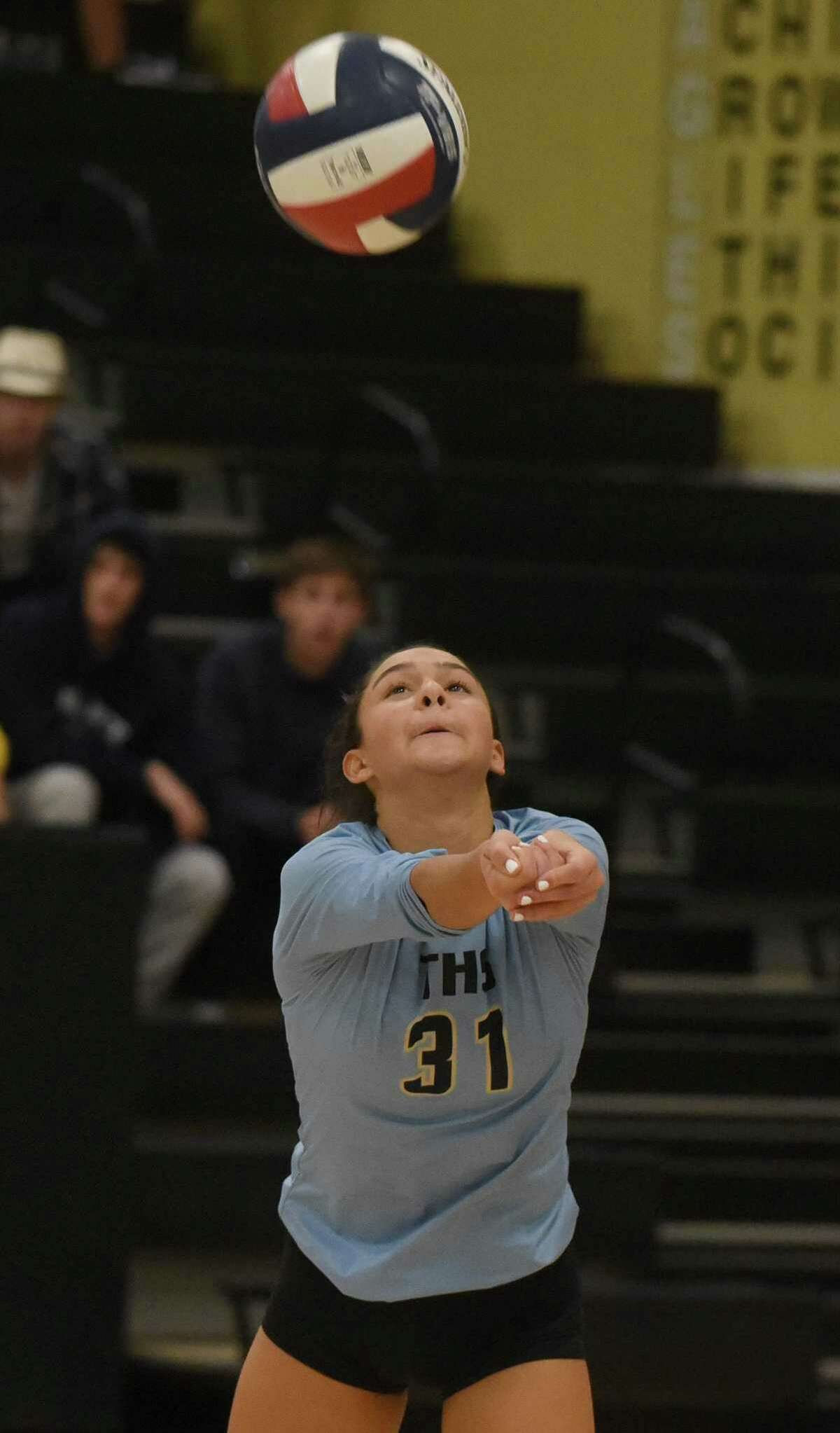Trumbull libero Ashleigh Johnson (31) keeps the ball up during an FCIAC girls volleyball quarterfinal game against New Canaan at Trumbull High School on Tuesday, Nov. 5, 2019.