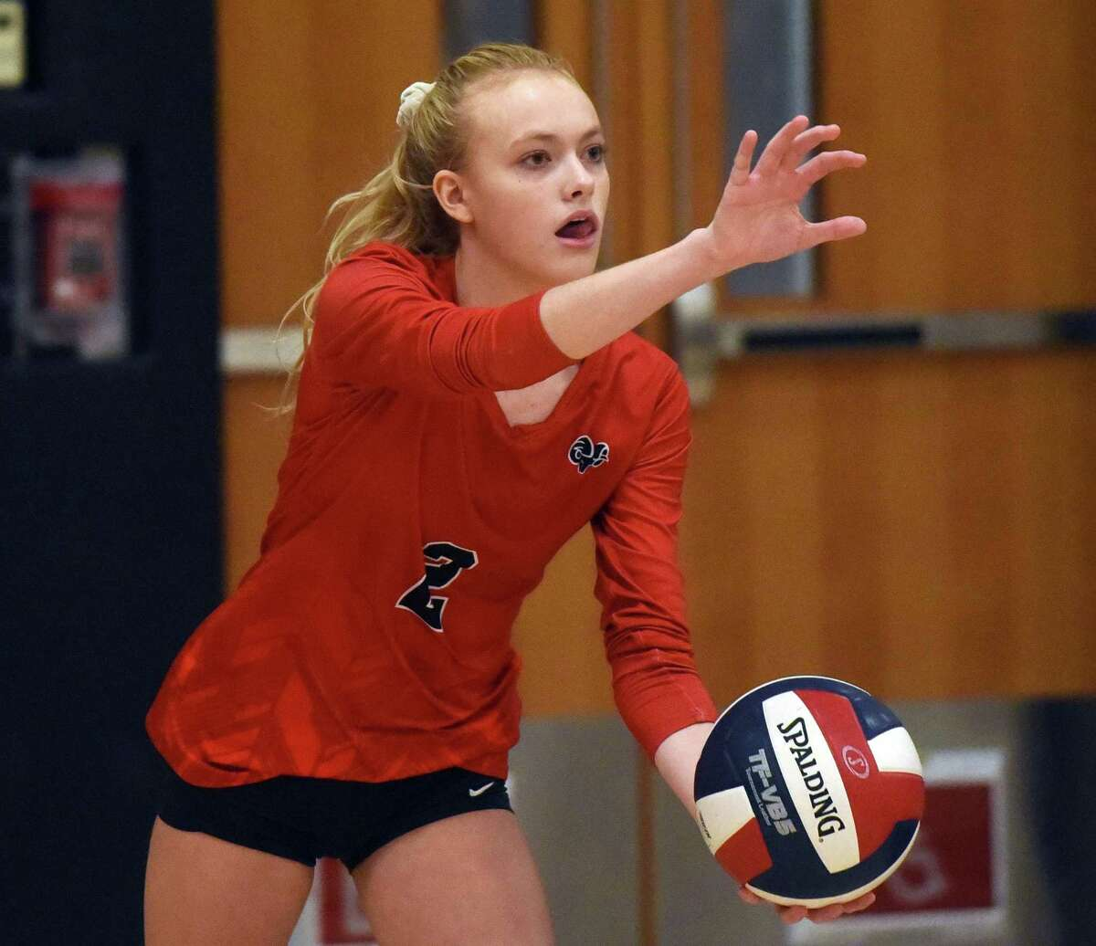 New Canaan's Elle Sneddon gets set to serve during an FCIAC girls volleyball quarterfinal game against Trumbull at Trumbull High School.