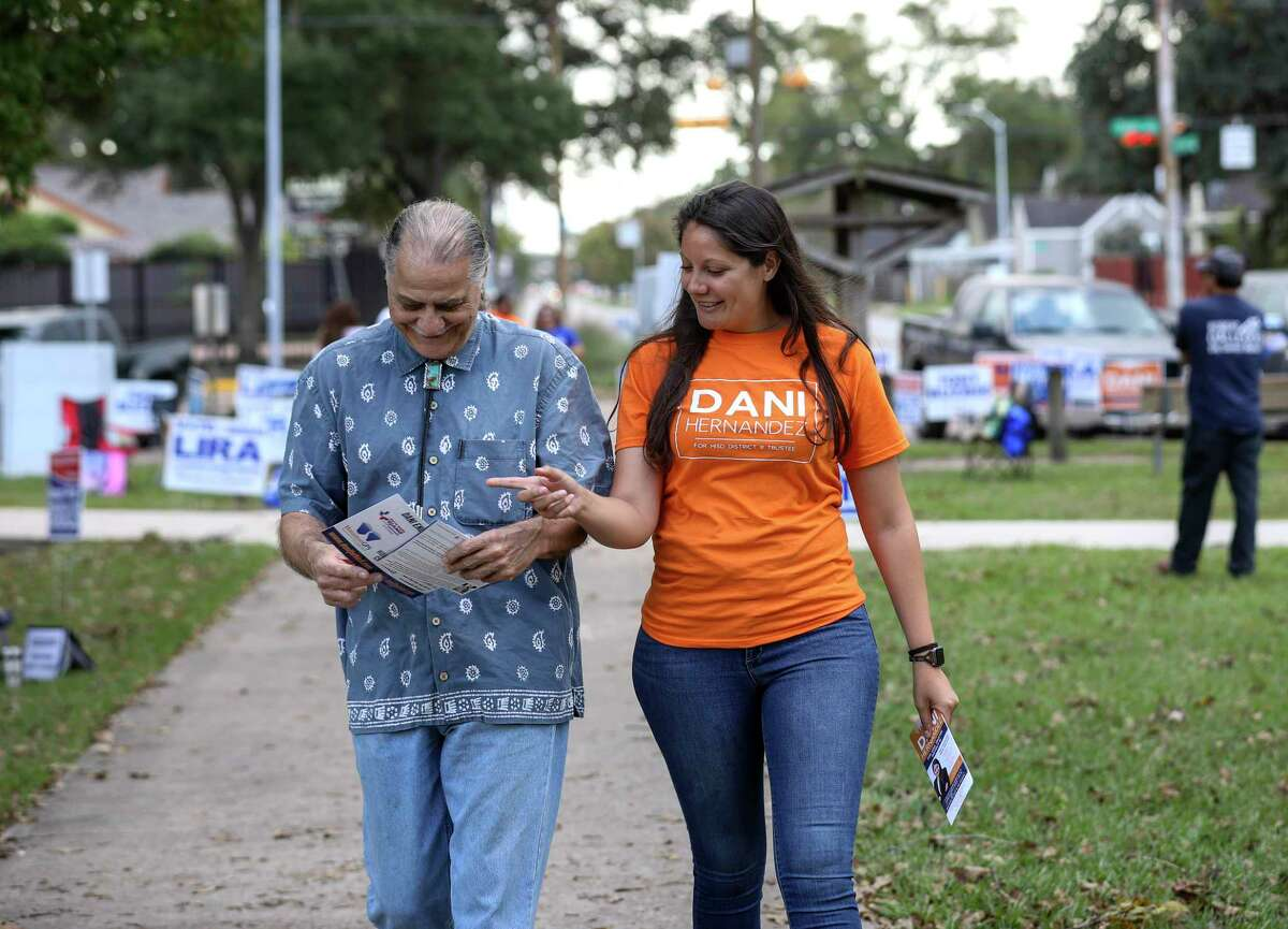 Dani Hernandez, right, a candidate for Houston ISD Board of Trustees District III, talks with Roland Lopez before he votes at Mason Park on Tuesday, Nov. 5, 2019, in Houston.