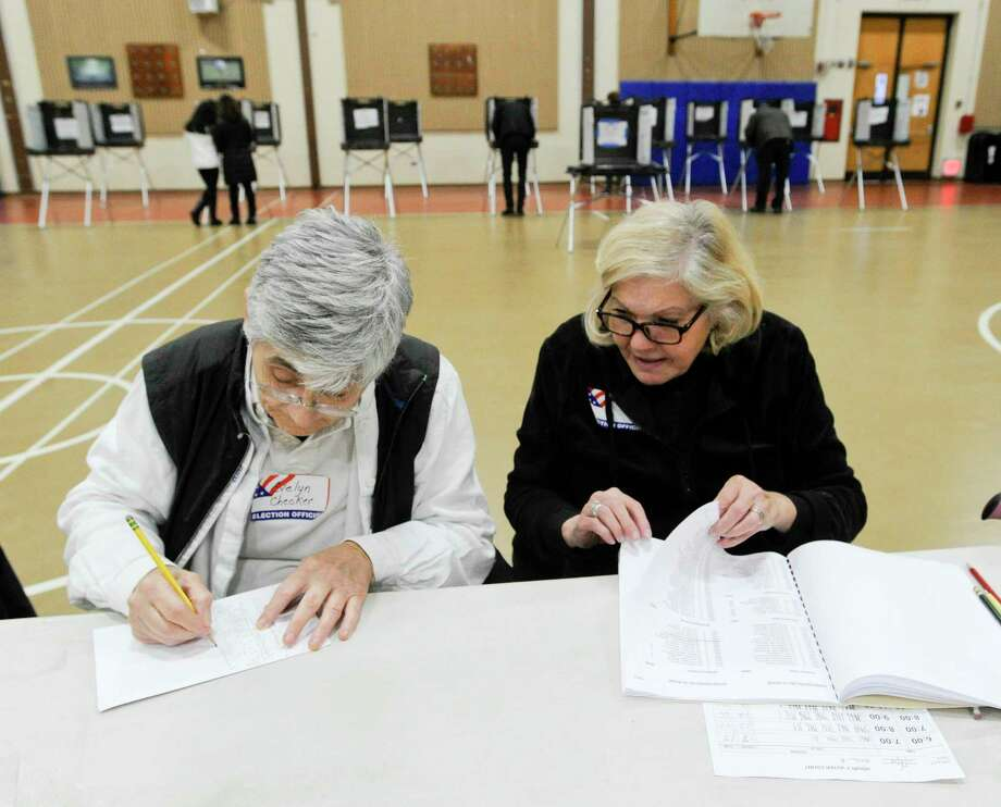From left, Evelyn Avoglia and Lucy Esposito tally up voter turn out at the District 14 polling site at Stillmeadow Elementary School on Nov. 5, 2019 in Stamford, Connecticut. Election workers are task with keeping hourly records of voter turnout while the polls are open. Photo: Matthew Brown / Hearst Connecticut Media / Stamford Advocate