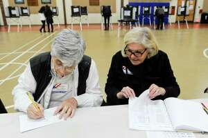From left, Evelyn Avoglia and Lucy Esposito tally up voter turn out at the District 14 polling site at Stillmeadow Elementary School on Nov. 5, 2019 in Stamford, Connecticut. Election workers are task with keeping hourly records of voter turnout while the polls are open.