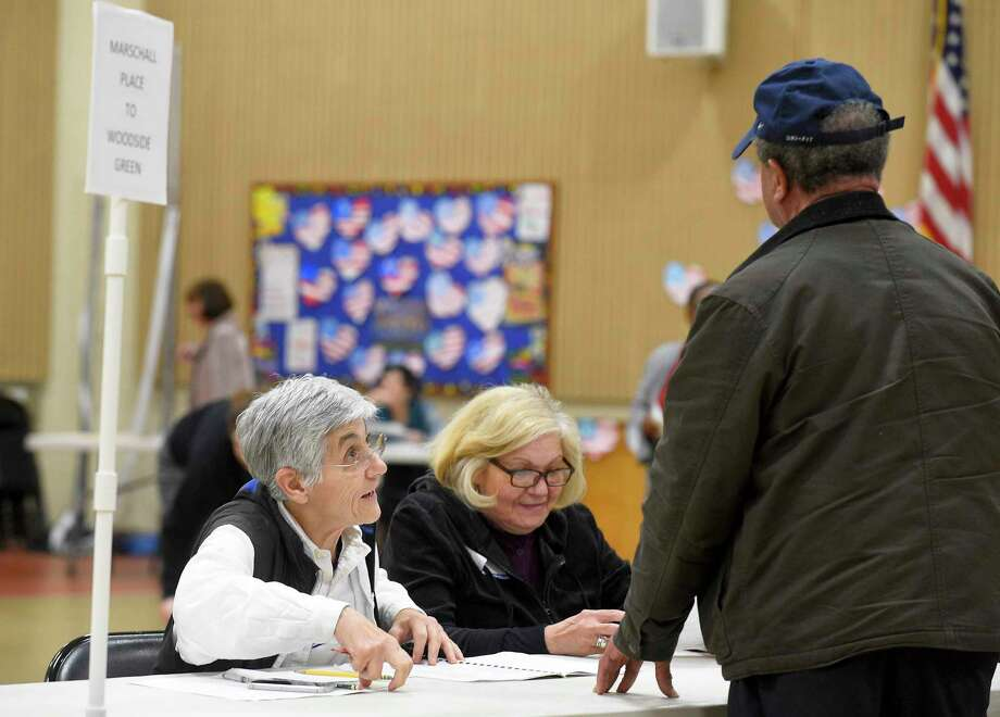 From left, Evelyn Avoglia and Lucy Esposito check in voters at the District 14 polling site at Stillmeadow Elementary School on Nov. 5, 2019 in Stamford, Connecticut. Photo: Matthew Brown / Hearst Connecticut Media / Stamford Advocate