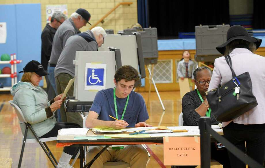 Polling places, seen here during last year's municipal elections, are going to look different this year as registrars take steps to protect against the coronavirus. Photo: Matthew Brown / Hearst Connecticut Media / Stamford Advocate