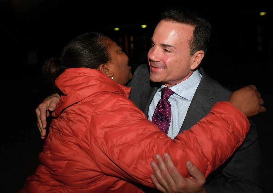 Supporter Beronica Gill hugs Bridgeport Mayor Joe Ganim outside the polling place at the former Harding High School in Bridgeport, Conn. on Tuesday, November 5, 2019. Photo: Brian A. Pounds / Hearst Connecticut Media / Connecticut Post