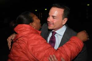 Supporter Beronica Gill hugs Bridgeport Mayor Joe Ganim outside the polling place at the former Harding High School in Bridgeport, Conn. on Tuesday, November 5, 2019.