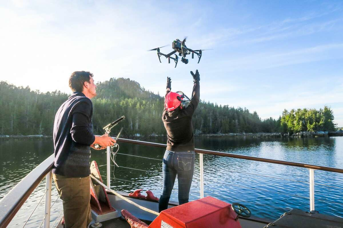 A team-member launching the drone. Photo credit: Andrew Trites/ University of British Columbia