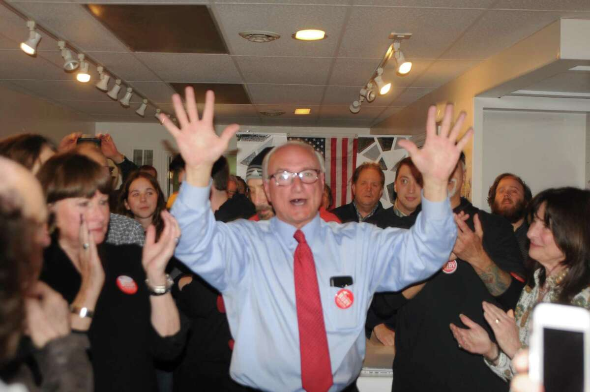 Ridgefield's First Selectman Rudy Marconi celebrates his victory Tuesday night.