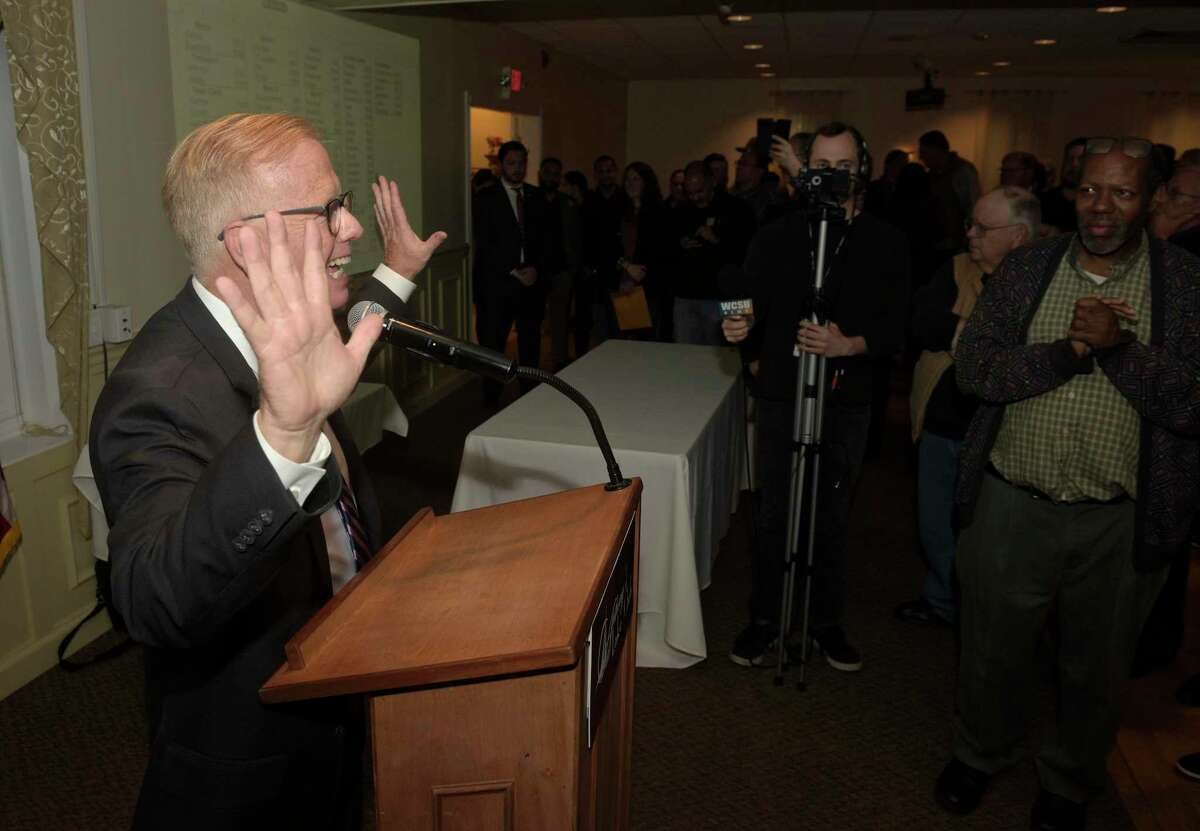 Danbury Mayor Mark Boughton signals 10 terms Tuesday night after winning the Danbury mayorial election for the 10th time. Boughton was with supporters at Anthony's Lake Club in Danbury to watch the returns.