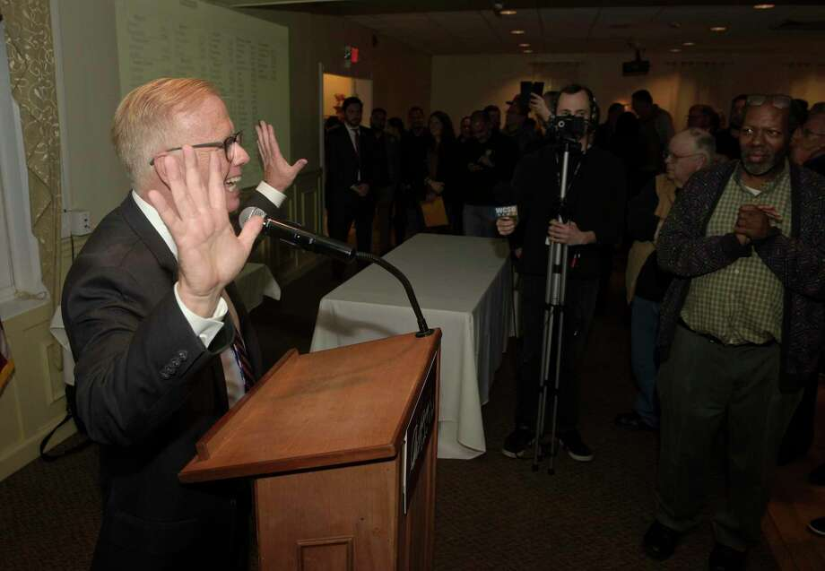 Danbury Mayor Mark Boughton signals 10 terms Tuesday night after winning the Danbury mayorial election for the 10th time. Boughton was with supporters at Anthony's Lake Club in Danbury to watch the returns. Photo: H John Voorhees III / Hearst Connecticut Media / The News-Times