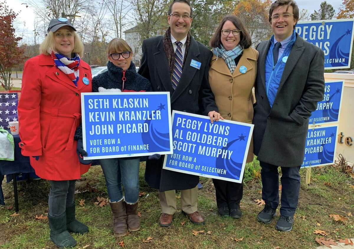 Democrat candidate for first selectman Peggy Lyons, second from right, with campaign workers at the polls at District 1 Madison Senior Center on Nov. 5, 2019. Lyons would find out that night that she won the race.
