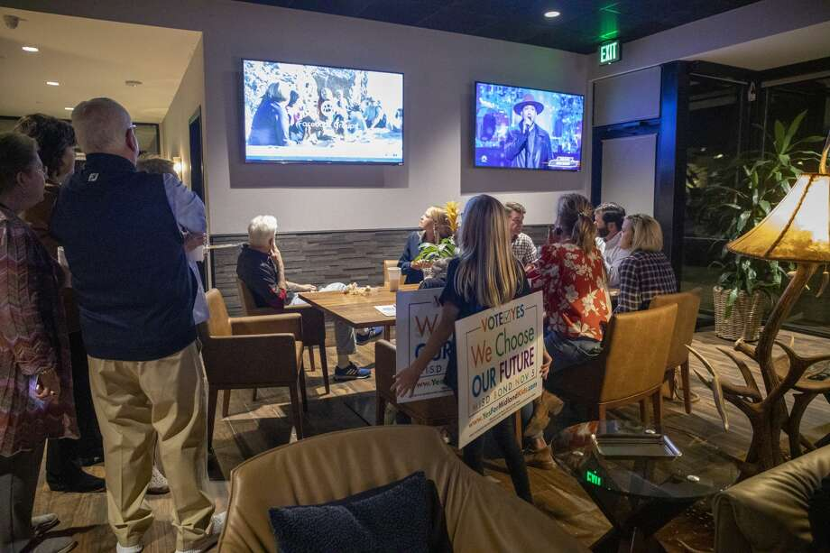 People gather for election night results for the MISD bond Tuesday, Nov. 5, 2019 at Ally Outdoors.  Jacy Lewis/Reporter-Telegram Photo: Jacy Lewis/Reporter-Telegram