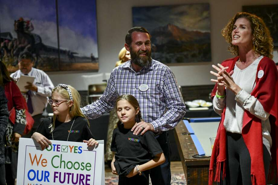 Christine Foreman, right, addresses the crowd with Fay, from left, Willa and Dave Joyner during election night results for the MISD bond Tuesday, Nov. 5, 2019 at Ally Outdoors.  Jacy Lewis/Reporter-Telegram Photo: Jacy Lewis/Reporter-Telegram