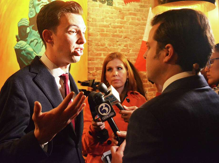 Mayor elect Ben Florsheim speaks to a TV reporter at La Boca restaurant in Middletown following the news that he had beat Common Council Minority Leader Sebastian N. Giuliano Tuesday night. Photo: Cassandra Day / Hearst Connecticut Media