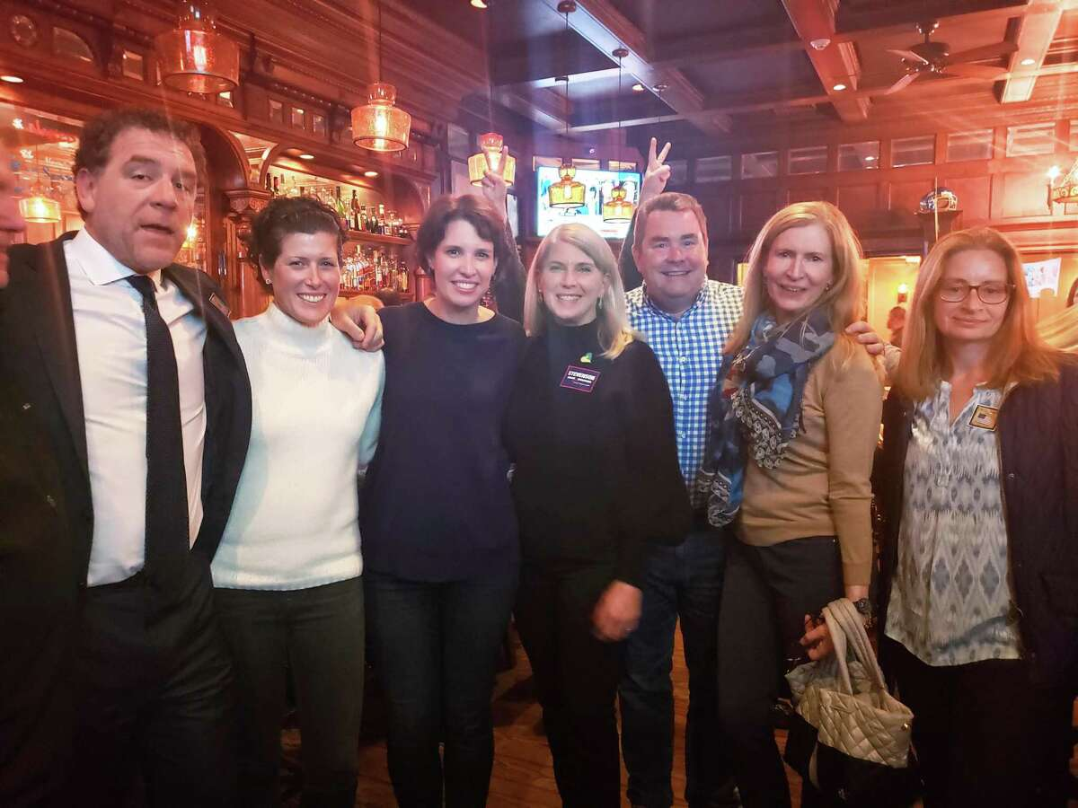 Republican candidates Jim Palen, left, Taylor Carter, both Board of Finance, Board of Ed member Jill McCammon, First Selectman Jayme Stevenson, P&Z Commissioner Larry Warble, and Selectman Christa McNamara were joined at the Goose by newly elected Democratic Selectman Sarah Neumann.