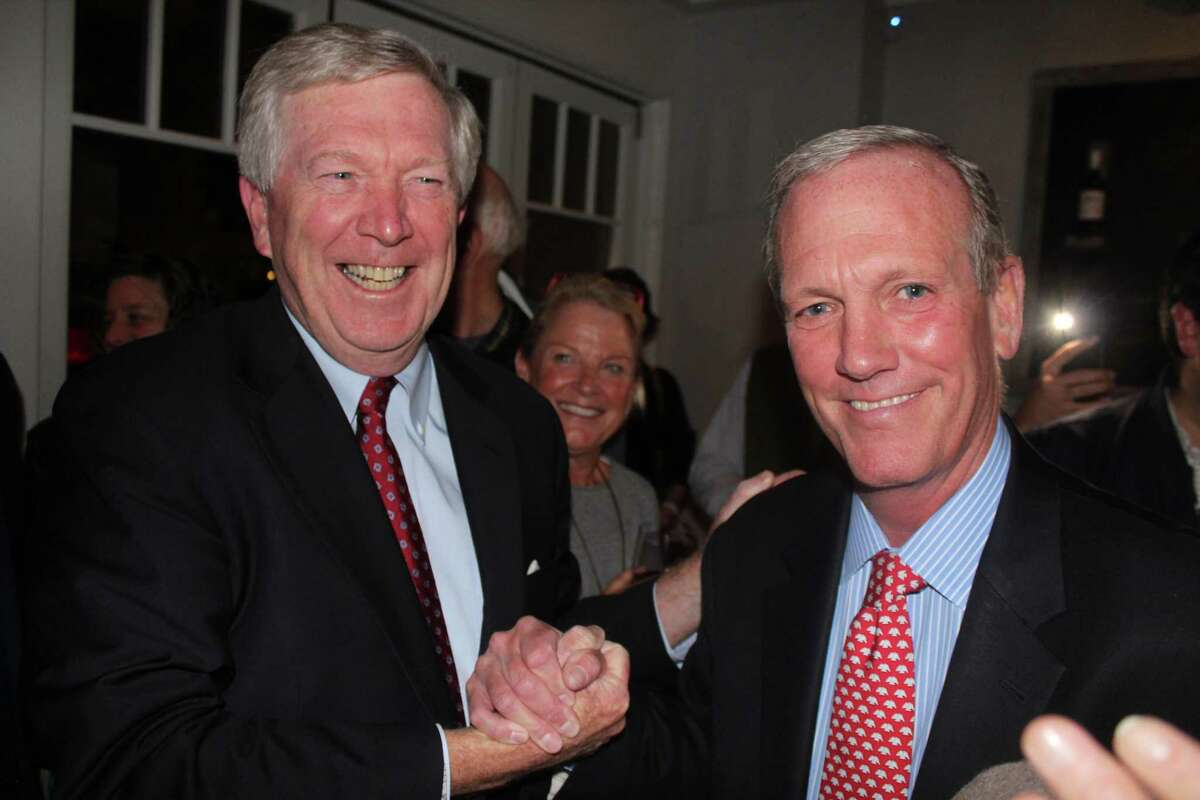 New Canaan First Selectman Kevin Moynihan and Selectman Nick Williams celebrate their reelection with other Republicans at Baldanza on Tuesday night.