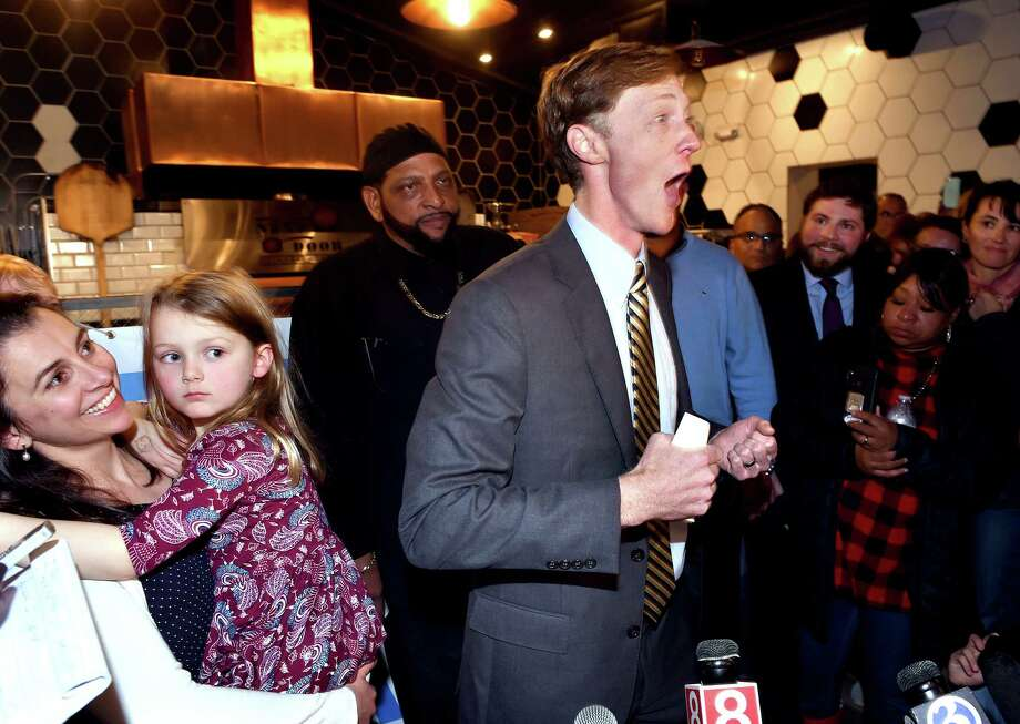 Justin Elicker (center) celebrates his victory in the mayoral race against incumbent Mayor Toni Harp with his wife, Natalie (left) and daughter, Molly, 4, at Next Door restaurant in New Haven on November 5, 2019. Photo: Arnold Gold, Hearst Connecticut Media / New Haven Register