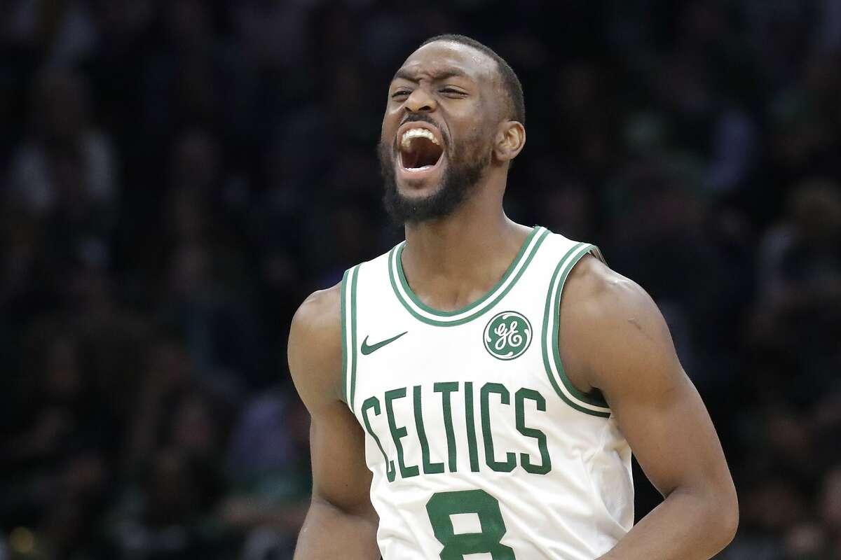 Boston Celtics guard Kemba Walker celebrates during the fourth quarter of the team's NBA basketball game against the New York Knicks, Friday, Nov. 1, 2019, in Boston. The Celtics won 104-102. (AP Photo/Elise Amendola)
