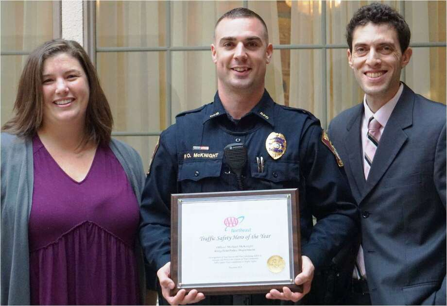 "Ridgefield Police Officer Mike McKnight was given the ""Traffic Safety Hero"" award from the American Automobile Association (AAA) for his traffic safety work in Ridgefield in 2019. Photo: Kerry Ducey"