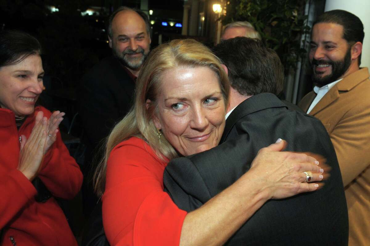 Brenda Kupchick is greeted by supporters as she arrives at her victory party at Flipside Burgers, in Fairfield, Conn. Nov. 5, 2019. Kupchick defeated incumbent Mike Tetreau for the First Selectman's seat in Tuesday's election.