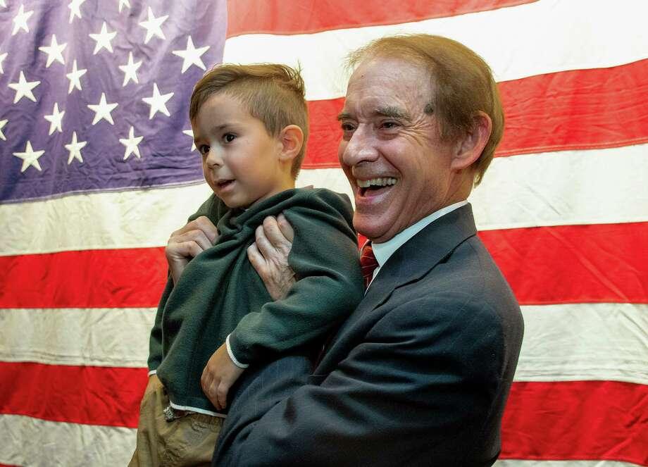 Wallingford Mayor William Dickinsonholds his grandson William Beckett Dickinson Photo: Associated Press File / Record-Journal