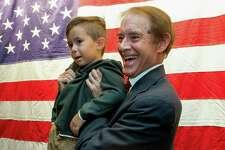 Wallingford Mayor William Dickinsonholds his grandson William Beckett Dickinson