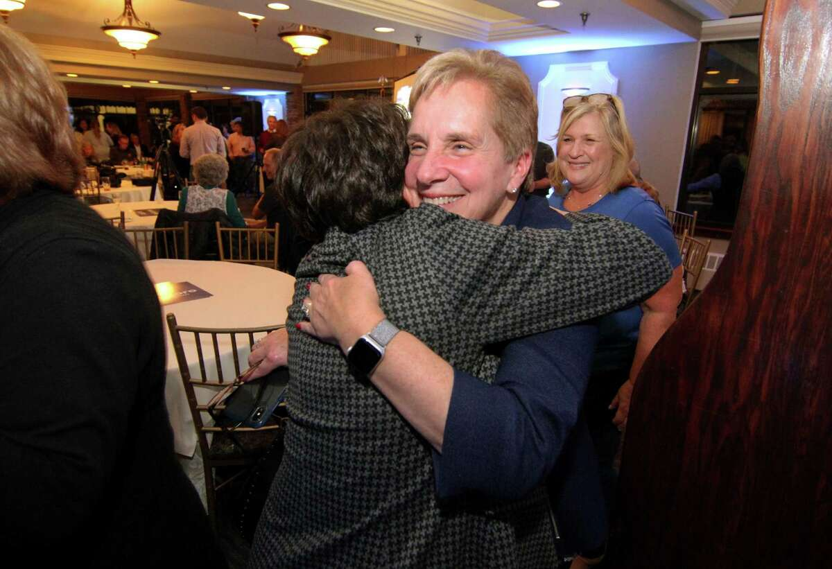 Trumbull First Selectman Vicki Tesoro, facing camera, gets a hug from volunteer Nancy Gardiner during Tesoro's campaign victory party at Tashua Knolls in Trumbull, Conn., on Tuesday Nov. 5, 2019.