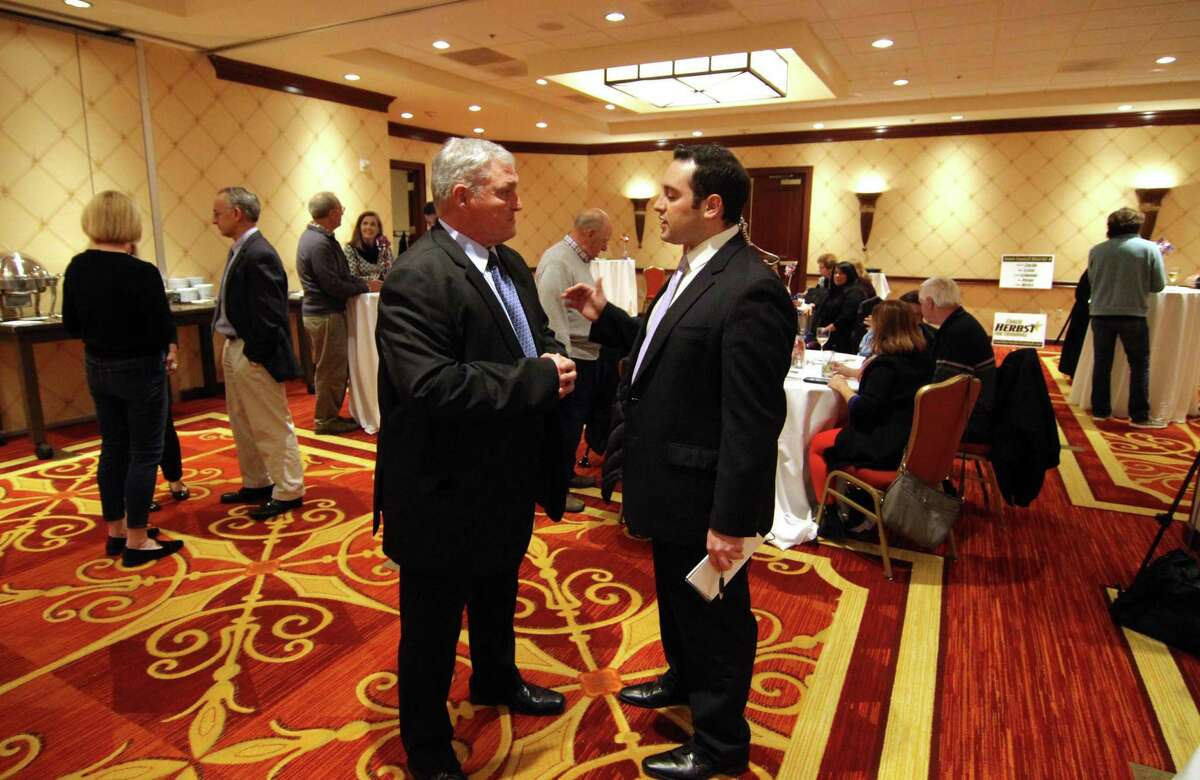 Mike Herbst, Republican candidate for Trumbull First Selectman, left, confers with a campaign official at his campaign party at Marriott Hotel in Trumbull, Conn., on Tuesday Nov. 5, 2019. Herbst lost his election bid to incumbent Vicki Tesoro.