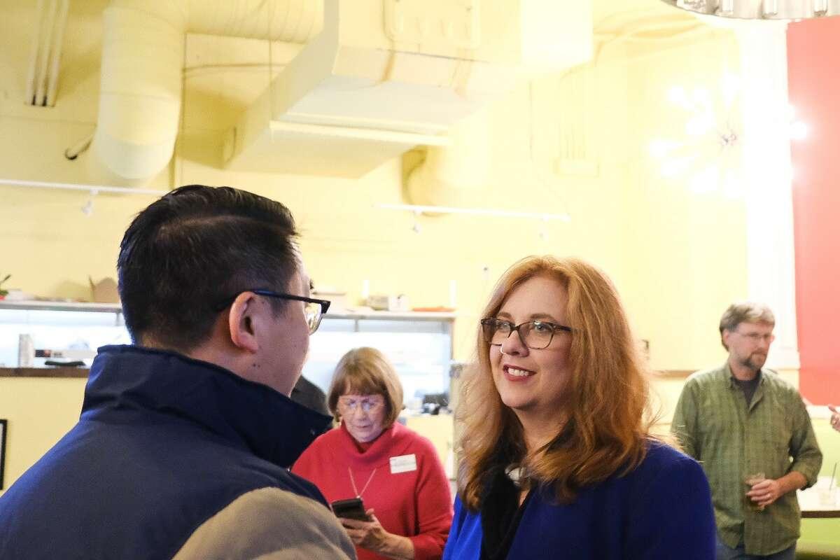 Seattle City Council District 1 incumbent Lisa Herbold speaks to Sen. Joe Nguyen.