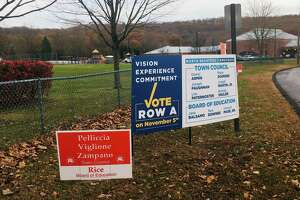 Campaign signs outside Jerome Harrison Elementary School in North Branford, one of the town's two polling places, on Nov. 5, 2019.