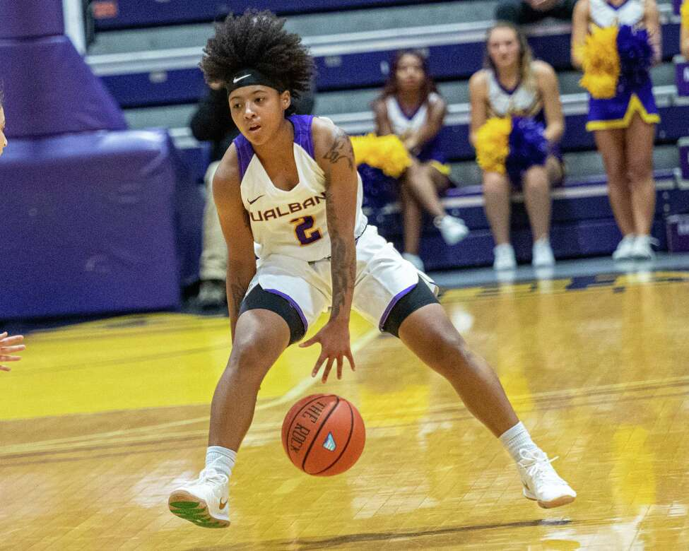 UAlbany guard Kyara Frames goes between her legs during the season opener against Columbia at the SEFCU Arena on Tuesday, Nov. 5, 2019 (Jim Franco/Special to the Times Union.)