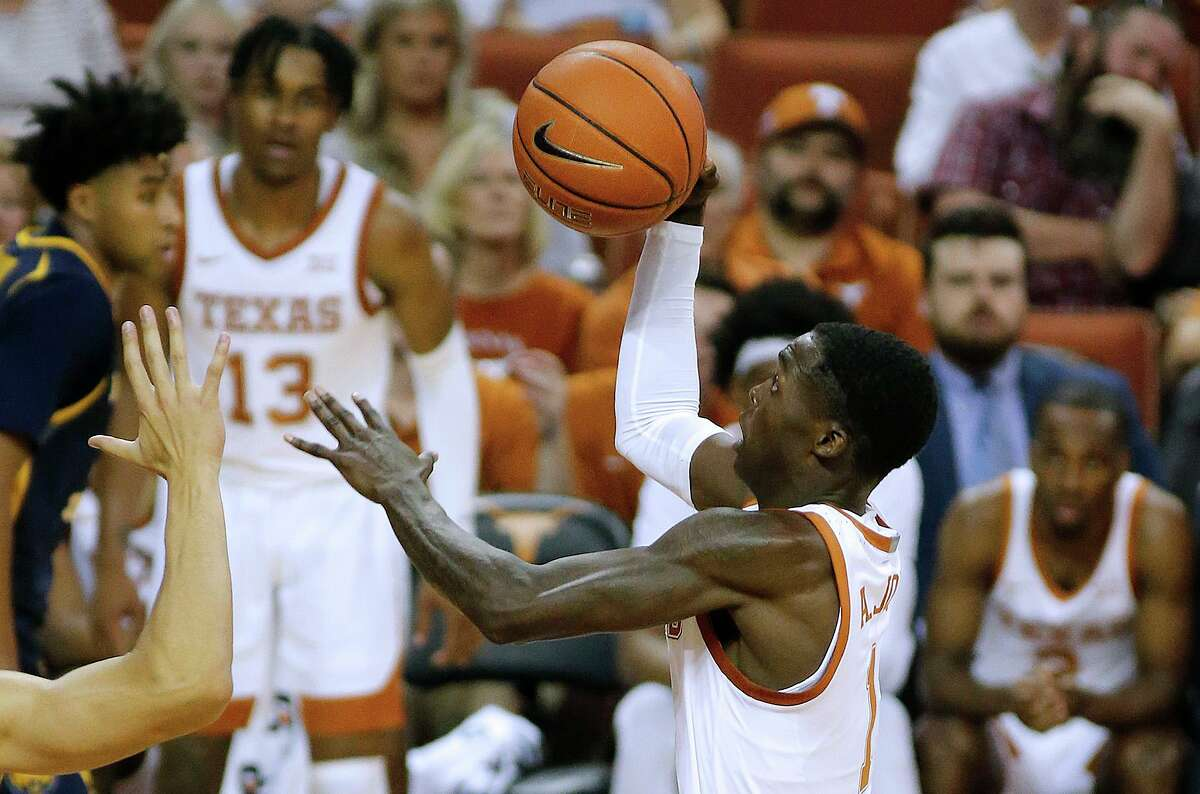 Andrew Jones, who has battled leukemia for two years, came off the bench to score a career-high 20 points in UT's home win.
