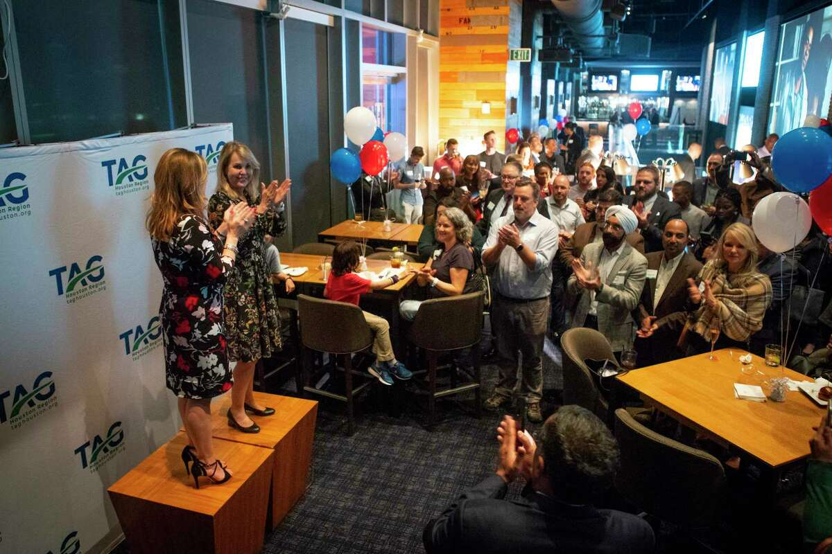 Andrea French (left), executive director of the Transportation Advocacy Group Houston Region, and Carrin Patman (right), chairwoman of the Metropolitan Transit Authority board, applaud as they address supporters of this election's Metro bond measure during a party at Biggio's in downtown Houston, Tuesday, Nov. 5, 2019. The Metro bond measure was showing a strong likelihood of passing after initial early voting results were released early Tuesday evening.