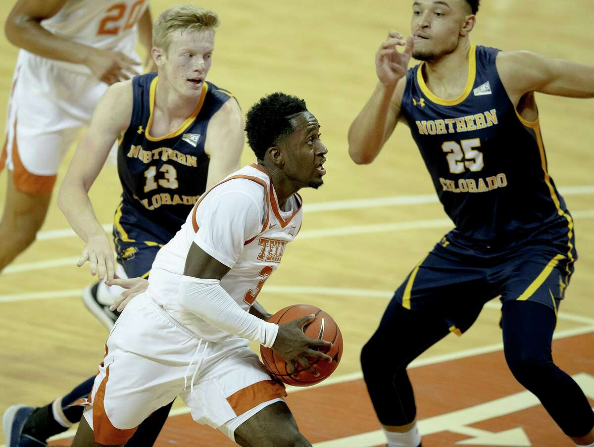 Texas guard Courtney Ramey (3) drives to basket during the first half of the team's NCAA college basketball game against Northern Colorado on Tuesday, Nov. 5, 2019, in Austin.