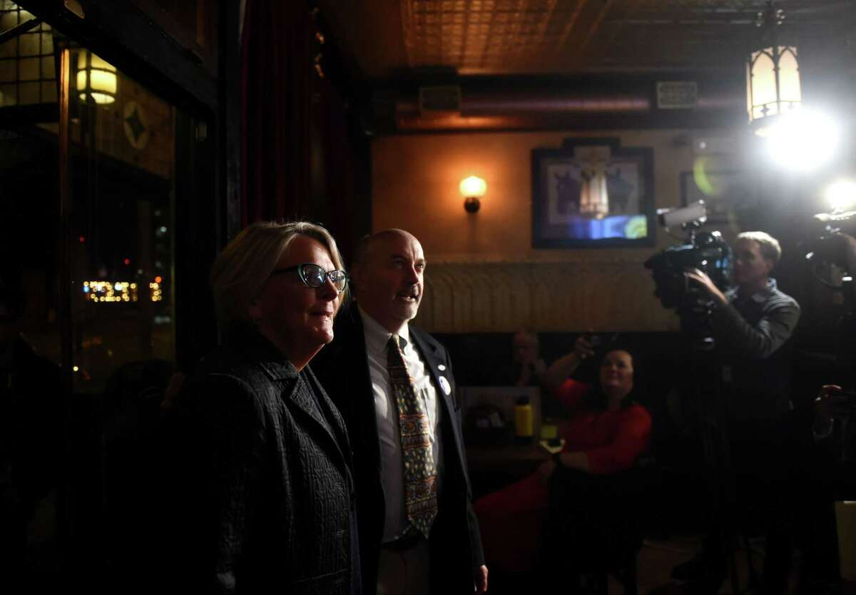 Troy Mayor Patrick Madden is joined by his wife, Amy Williams, left, as they watch election results come in on a television at Ryan's Wake on Tuesday, Nov. 5, 2019, during his election night party in Troy, N.Y. Madden was re-elected as Troy mayor. (Will Waldron/Times Union)